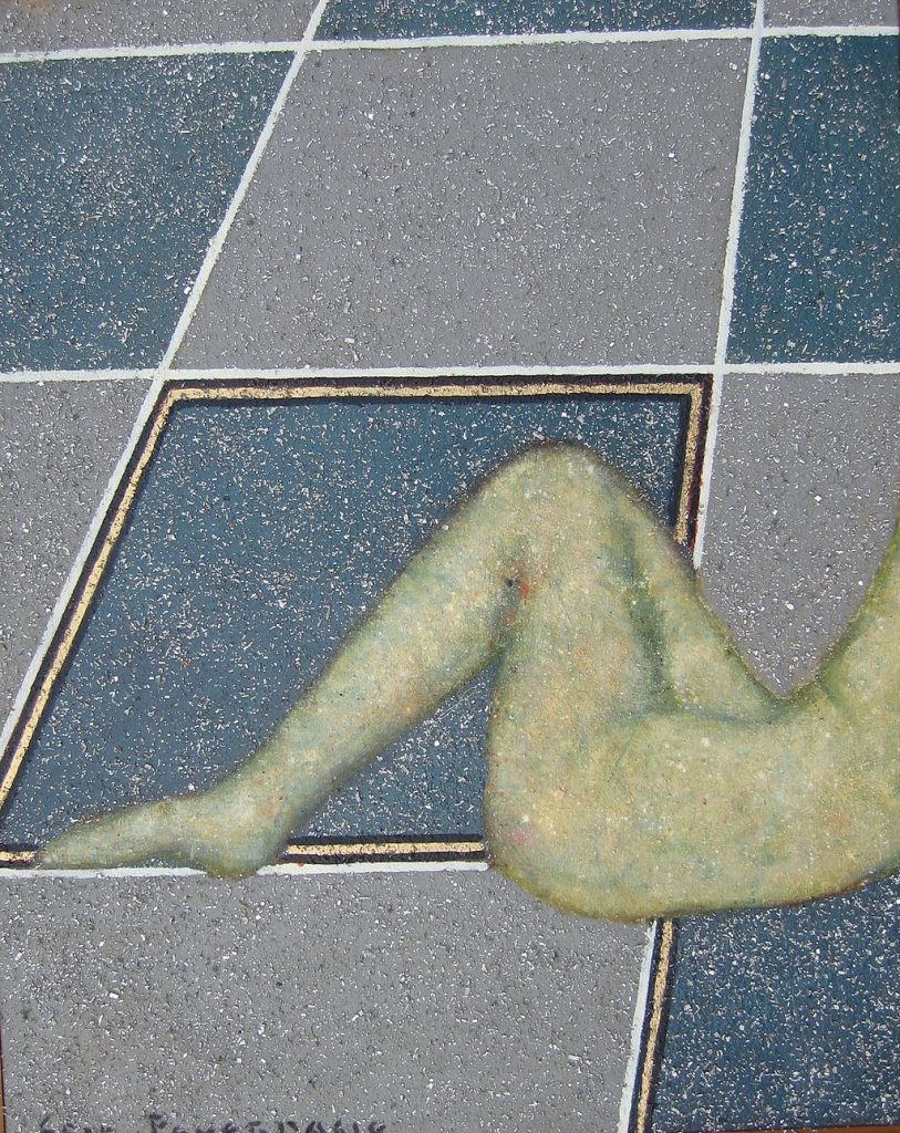 A figure, head and torso out of view, lies supine on a blue and grey tiled floor.